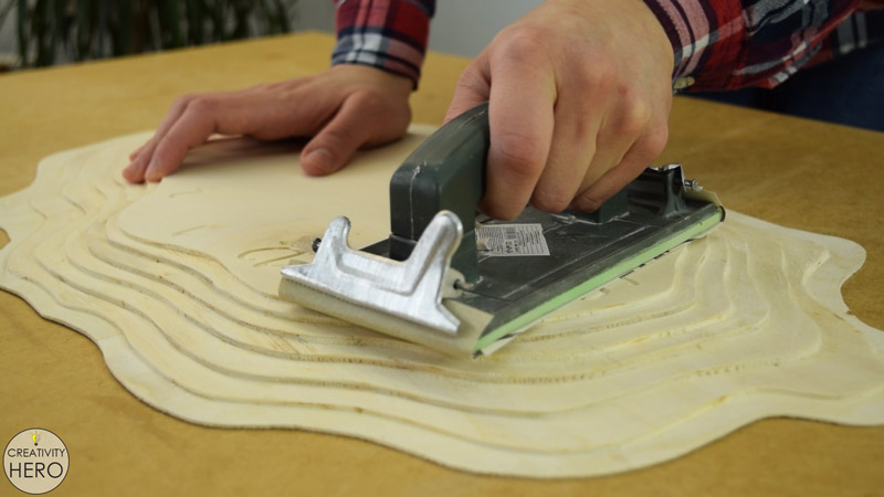 Making a Layered Plywood Wall Clock with a Tree Ring Shape 25 - Sanding the top layer of the plywood face